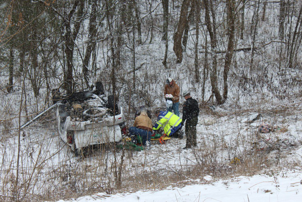 Vehicle Strikes Guardrail and Flips Down Embankment on I-40